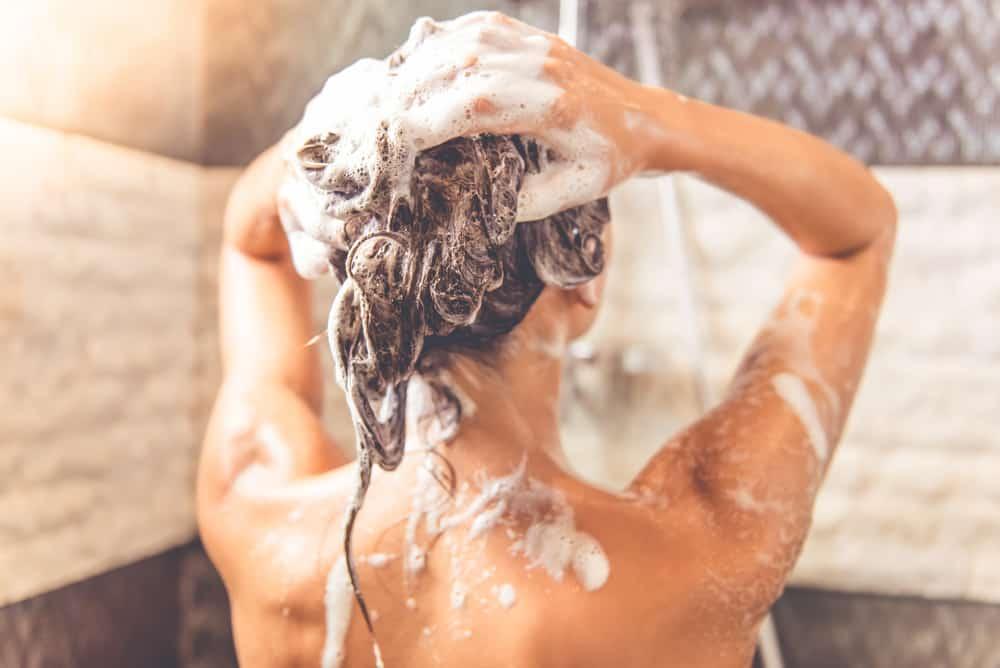 woman washing hair with shampoo