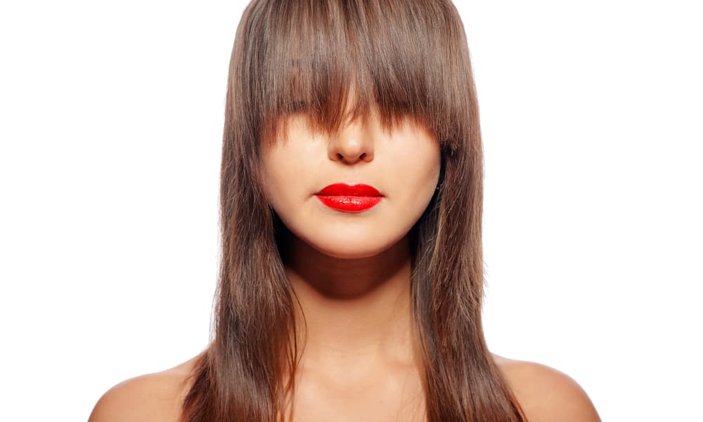 woman with grown out bangs