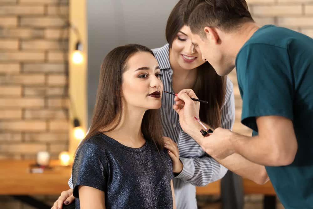 makeup school student applying makeup