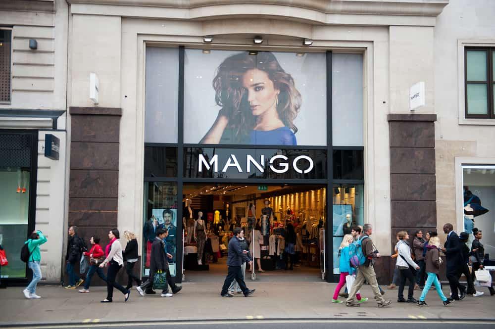 Mango storefront people walking