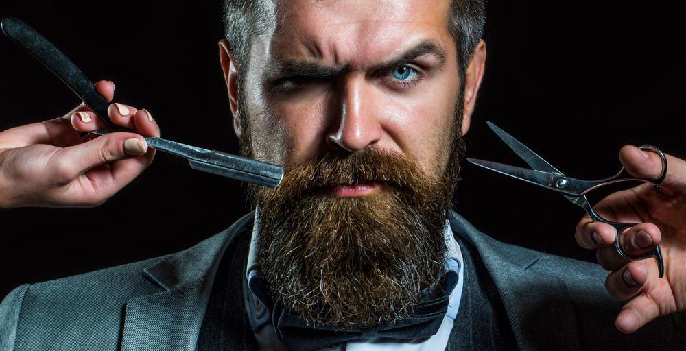 barber with scissors and razor