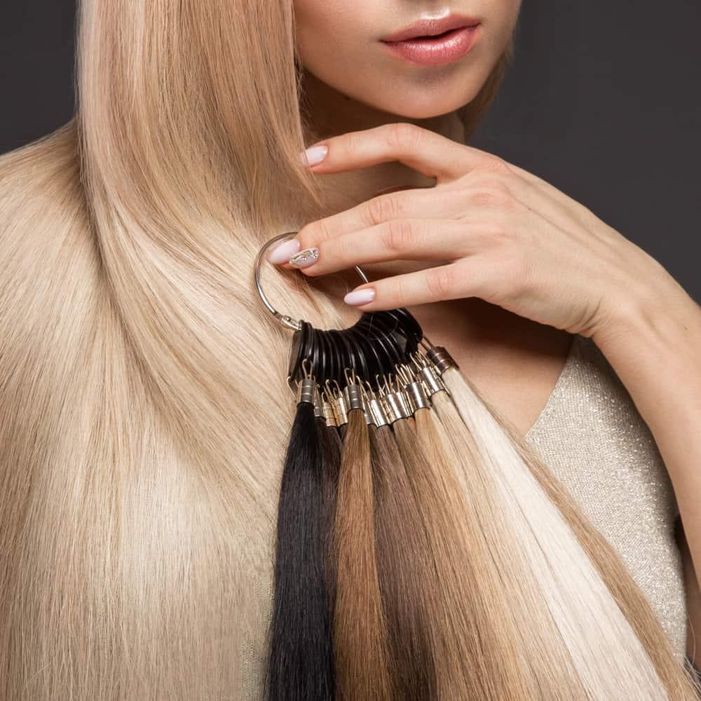 girl holding hair extension palette