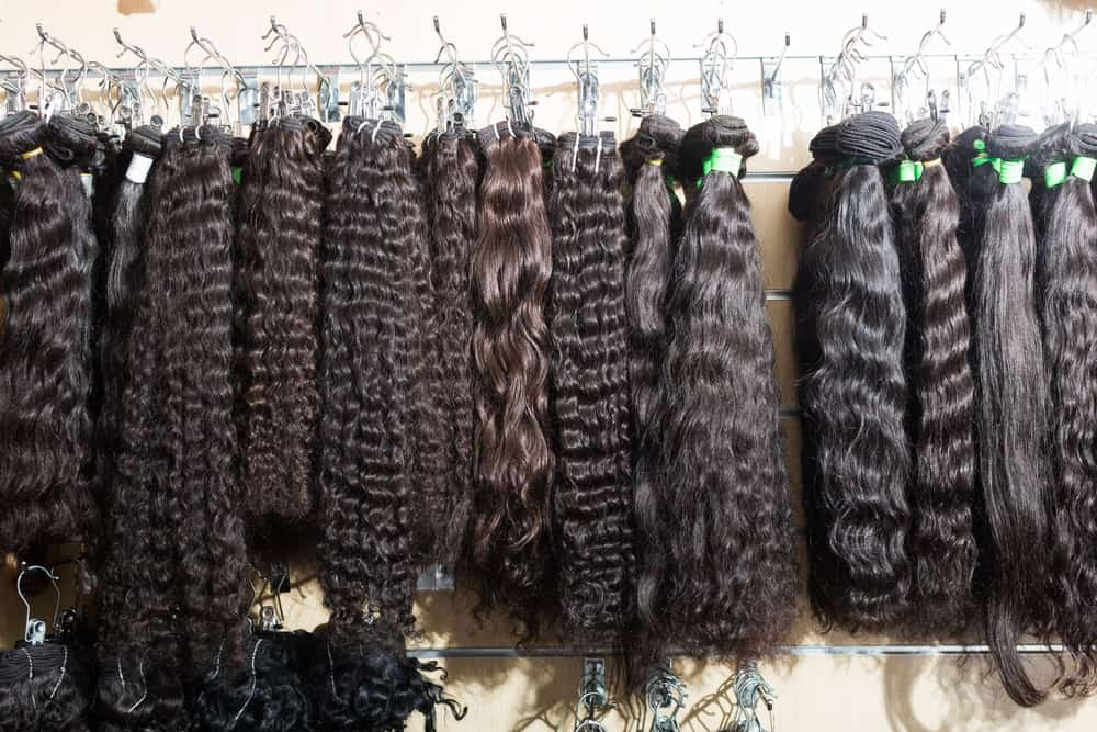 selection of hair extensions in a salon