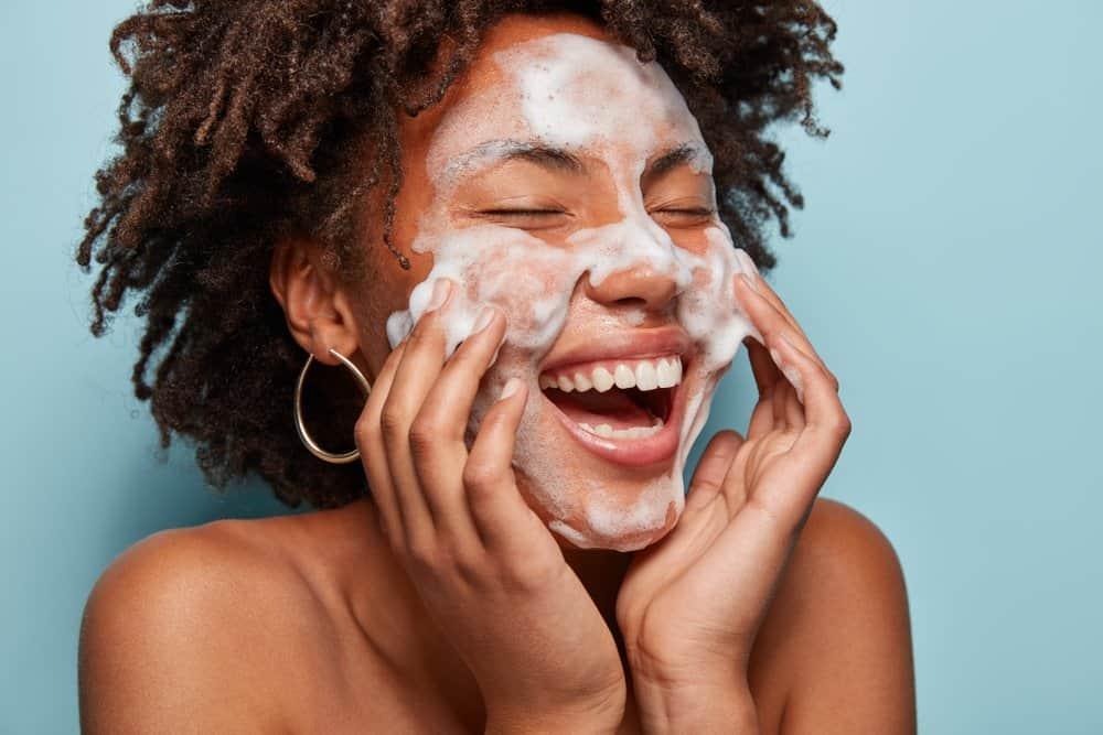 woman applying foaming cleanser