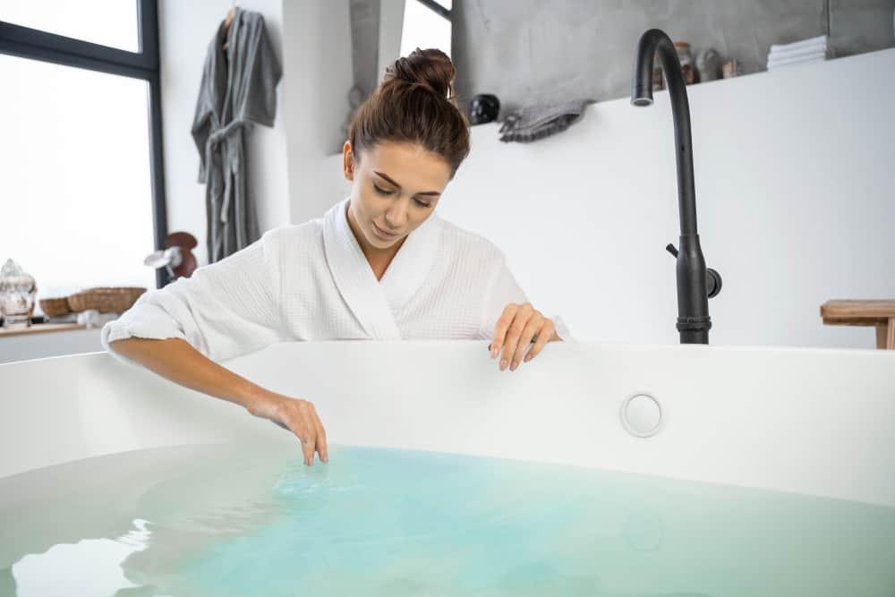 woman drawing bath water