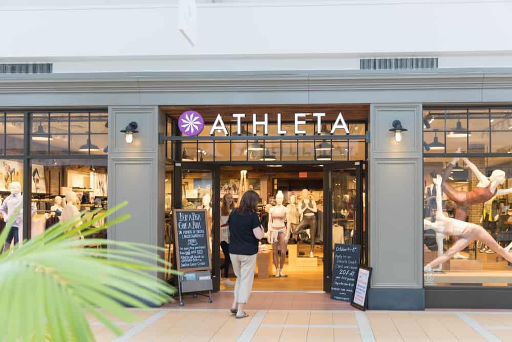 woman entering athleta store