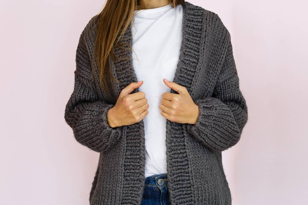 woman in fashionable gray knitted cardigan