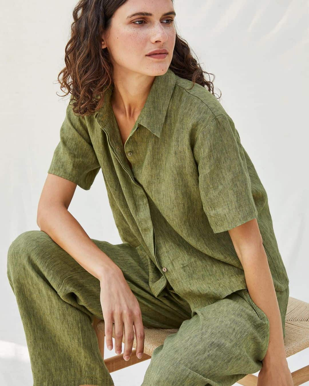 woman in linen shirt and pants