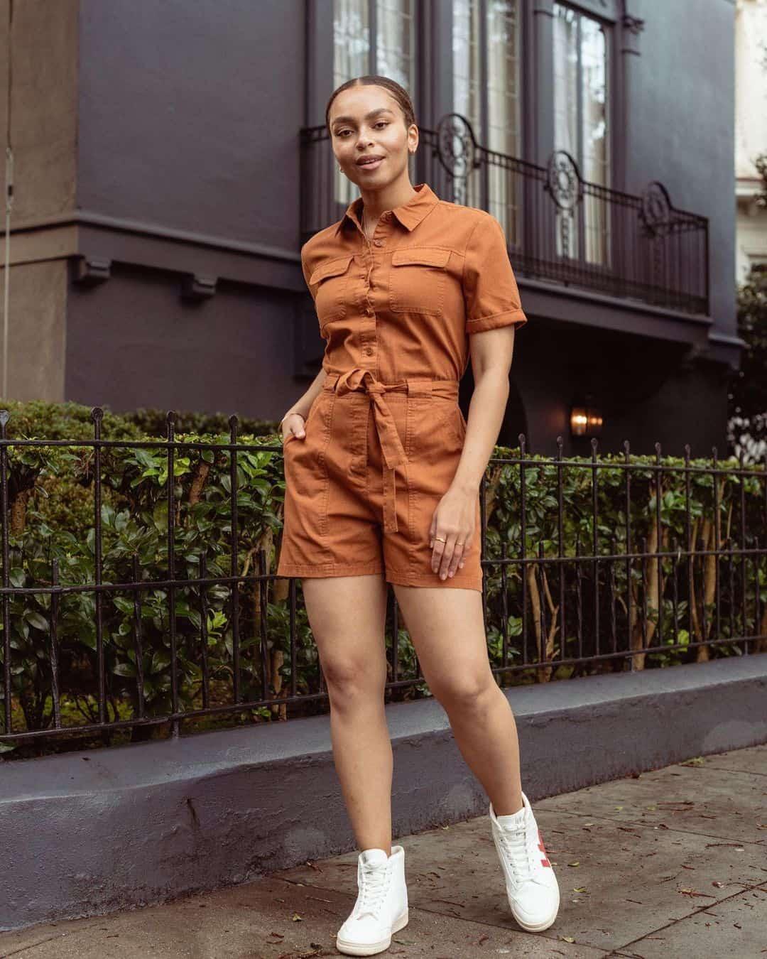 woman in orange romper