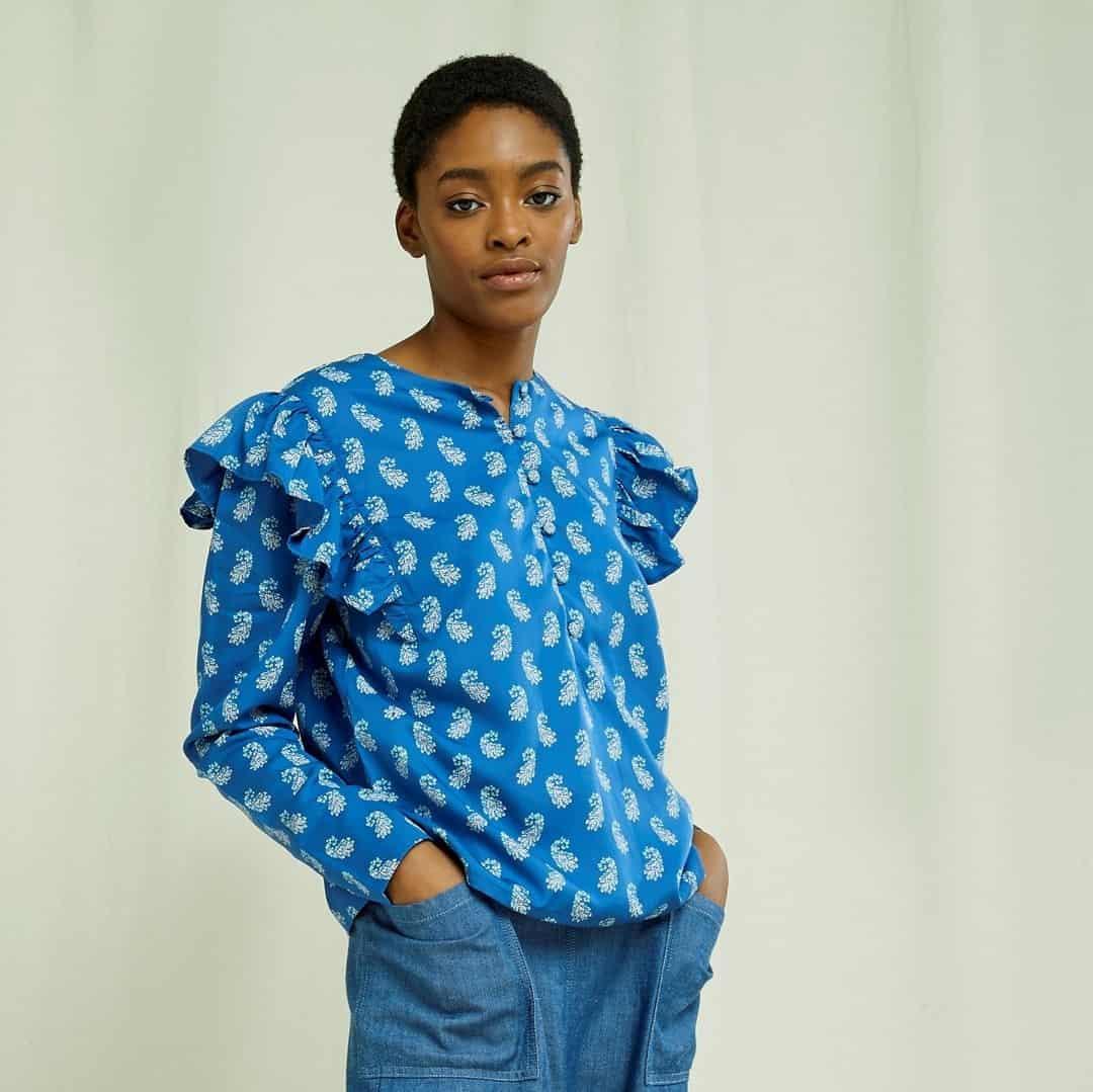 woman in printed ruffled blouse