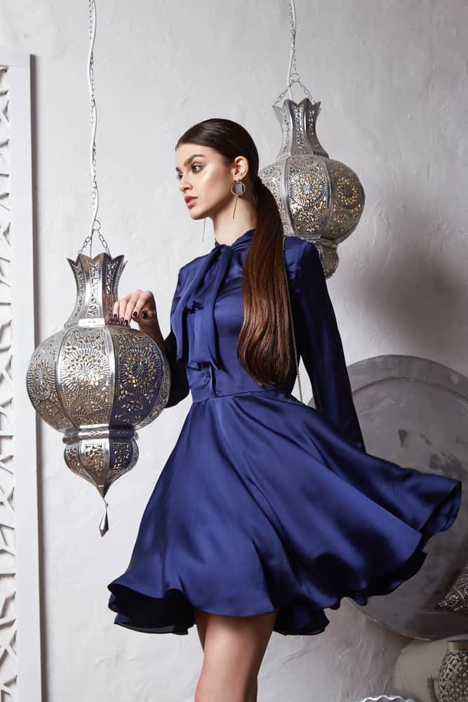 woman wearing blue silk dress