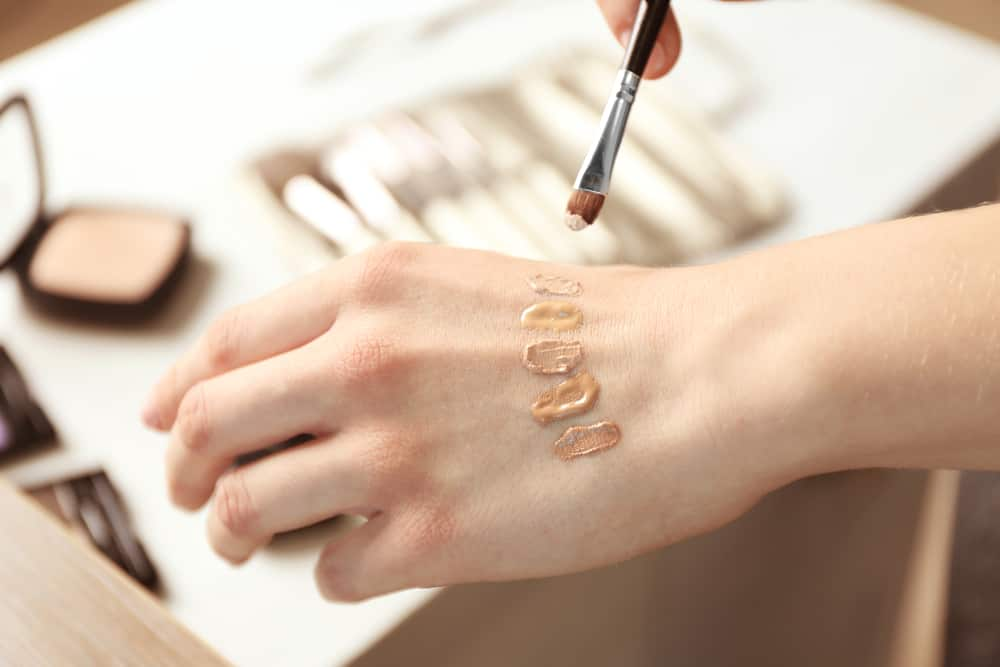 foundation on woman's hand
