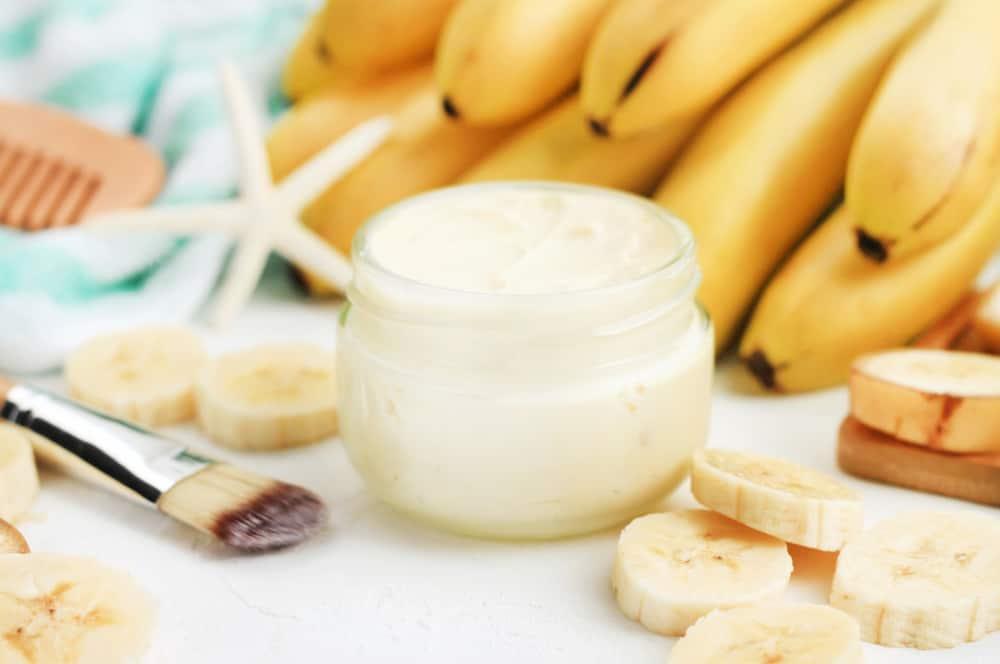 jar of banana hair mask and brush