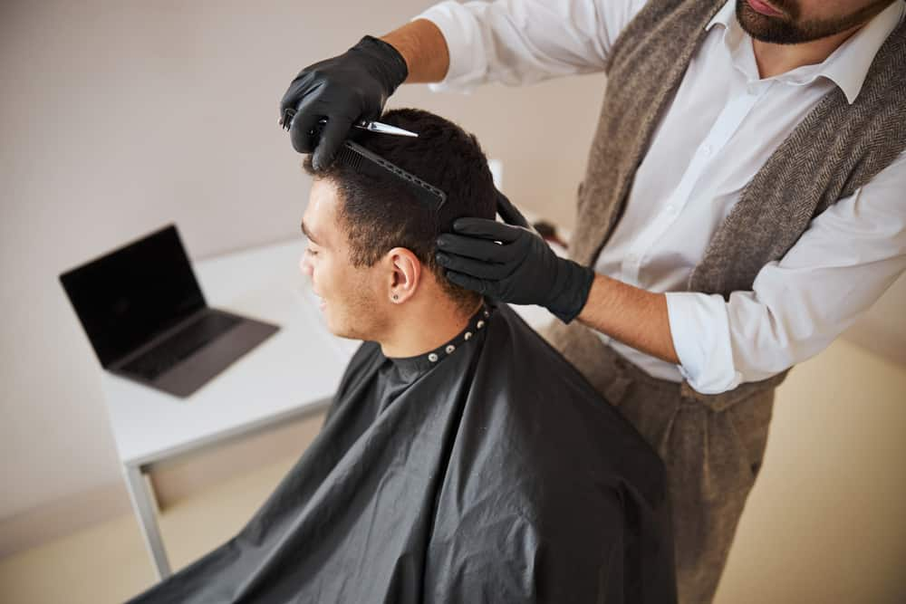 man receiving a haircut