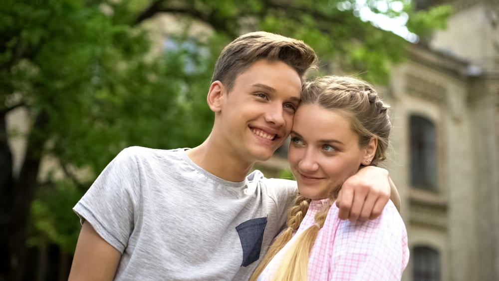 shy teenage couple together