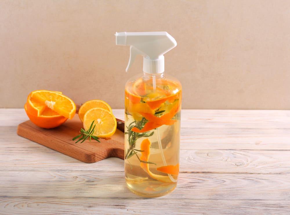 spray bottle of water and orange peels