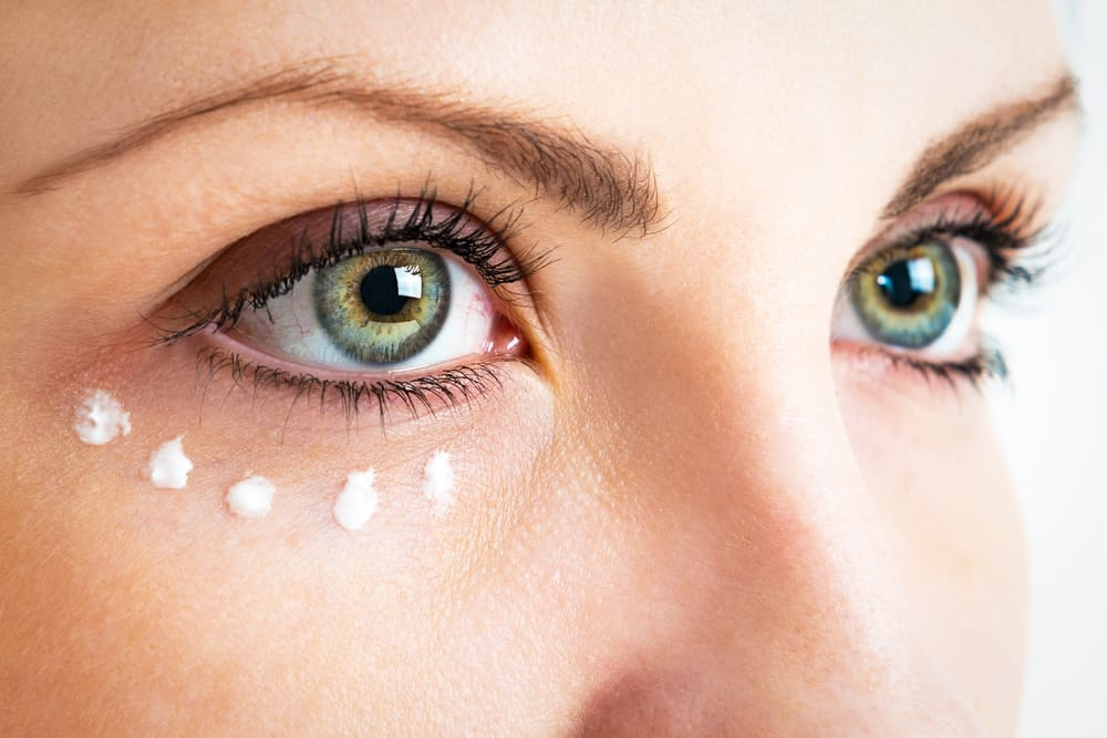 woman with dotted eye cream