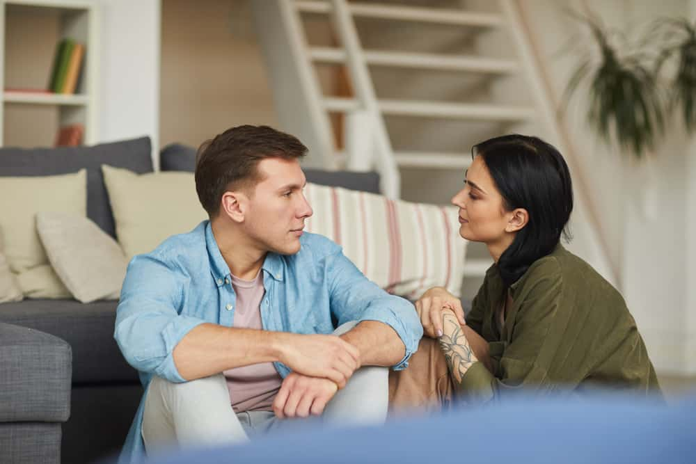 young couple having a serious conversation together