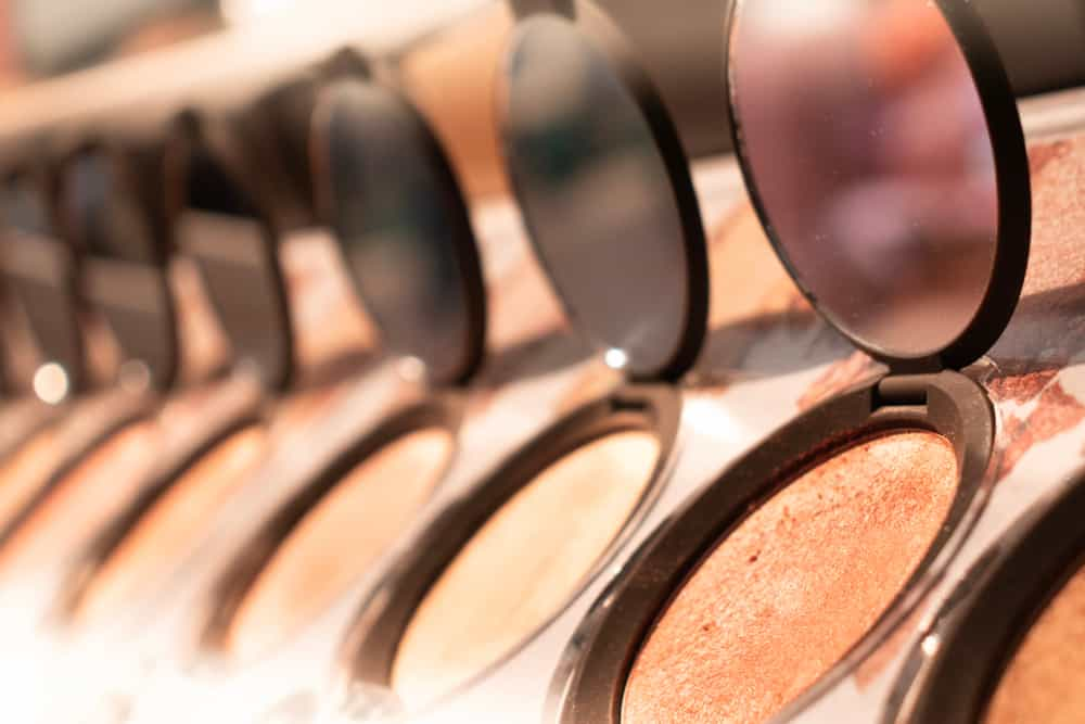 row of open bronzer compacts