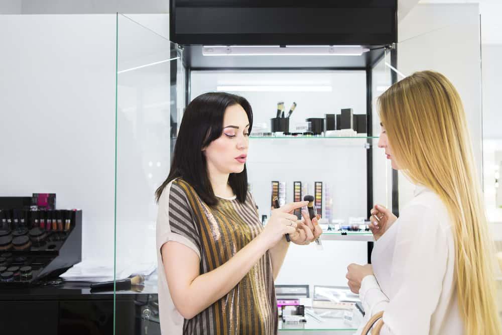 women at makeup counter
