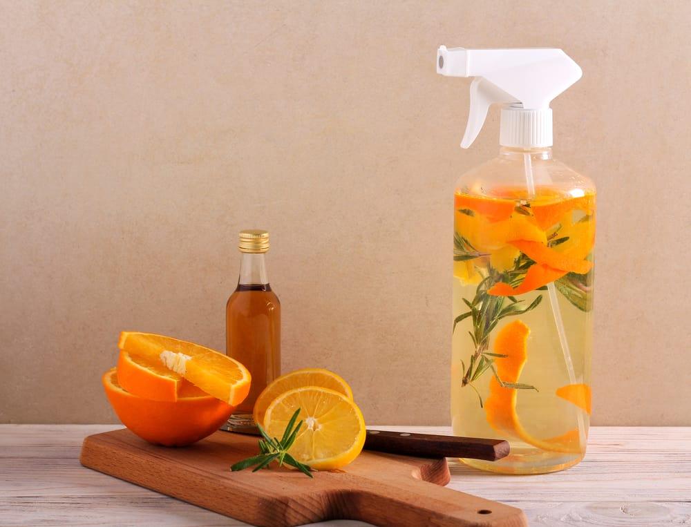 natural spray next to oranges