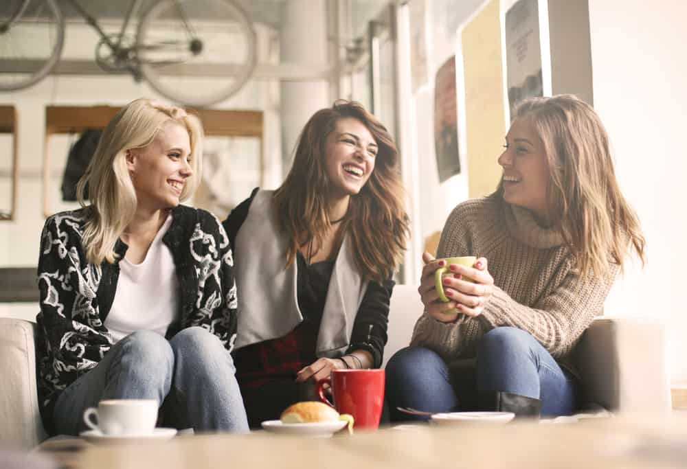 three women talking and laughing