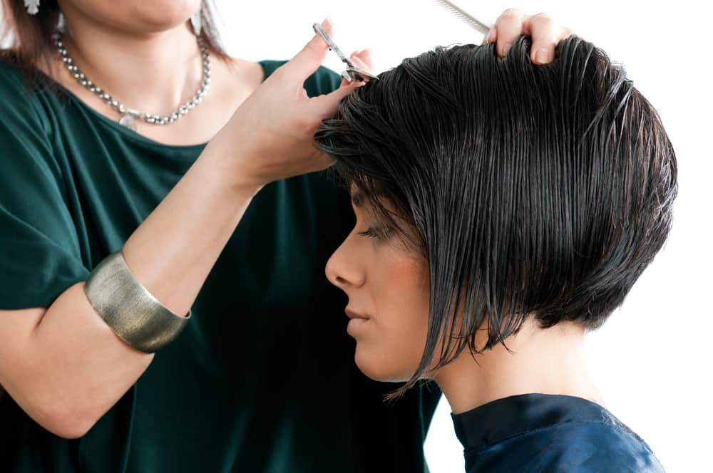 woman getting short haircut